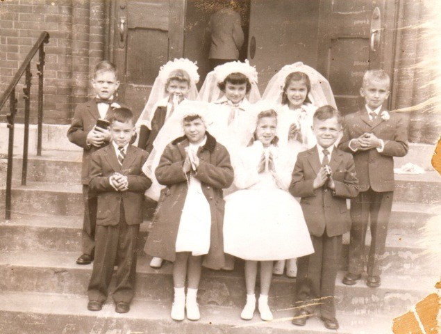 Louis' First Communion, he is pictured at the far right, front row.