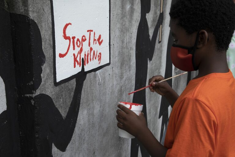 Photo Essay: The Wall Says 'Take a Knee'